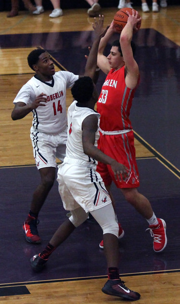 Hawken's Yonah Dori is double-teamed by Oberlin's Mark Robinson and Justin Smith as he looks to pass. Randy Meyers -- The Morning Journal