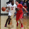 Oberlin's Mark Robinson brings the ball up court against the pressure applied by Hawken's Jimmy Clark. Randy Meyers -- The Morning Journal