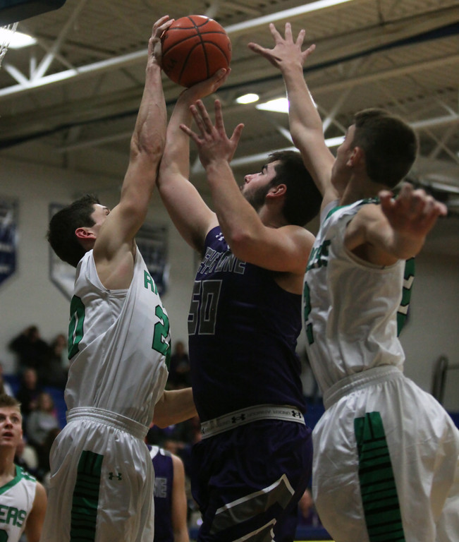 . Josh Borling of Columbia blocks the shot by Jeremy Gerhardinger of Keystone during the fourth quarter. Randy Meyers -- The Morning Journal