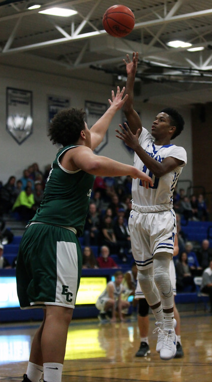 . Midview\'s Isiah Johnson hits a running jump shot over Branson Taylor of Elyria Catholic during the second quarter. Randy Meyers -- The Morning Journal