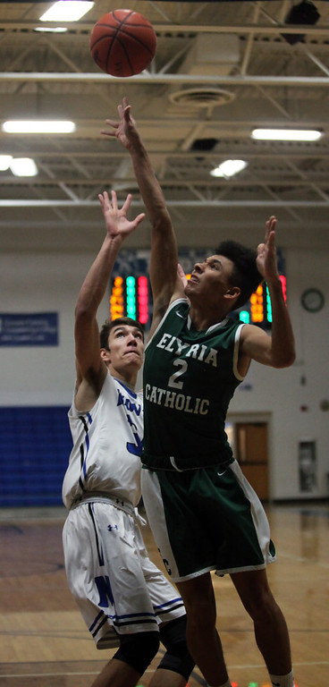 . Donovan Warfield of Elyria Catholic shoots over Jonny Manning of Midview during the first quarter. Randy Meyers -- The Morning Journal