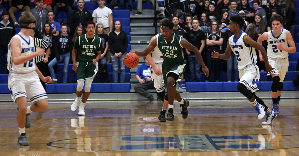 . Elyria Catholic\'s David Taylor brings the ball up court after grabbing a rebound during the first quarter. Randy Meyers -- The Morning Journal