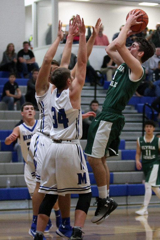 . Sean Szabo of Elyria Catholic shoots over the Midview defense during the first quarter. Randy Meyers -- The Morning Journal