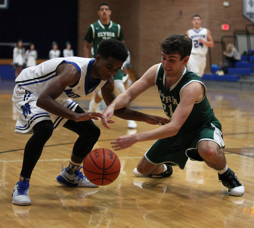 . Midview\'s Damian Malone and Sean Szabo of Elyria Catholic go after a loose ball. Randy Meyers -- The Morning Journal