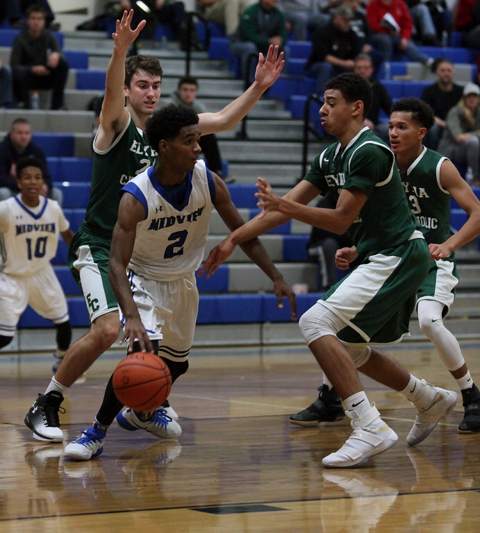 . Midview\'s Damian Malone tries to break the full court pressure applied by the Elyria Catholic defense. Randy Meyers -- The Morning Journal