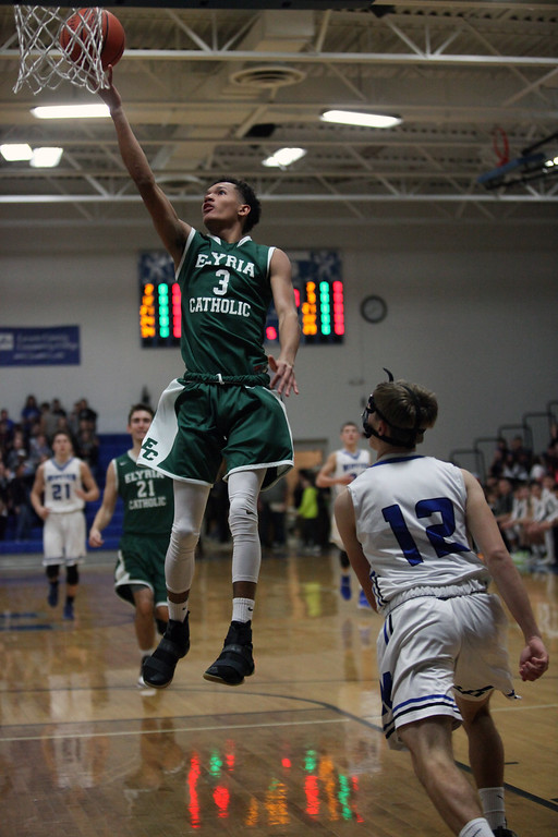 . Elyria Catholic\'s Dorian Crutcher drives and scores during the first quarter. Randy Meyers -- The Morning Journal