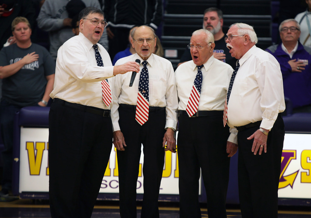 . Lorain\'s own South Shore 4 Quartet leads the singing of the national anthem. Randy Meyers -- The Morning Journal