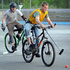 William Uber is pursued by Pat Morris during a bike polo match Thursday at the Stoltzman Road rink. <i>Pat Christman</i>