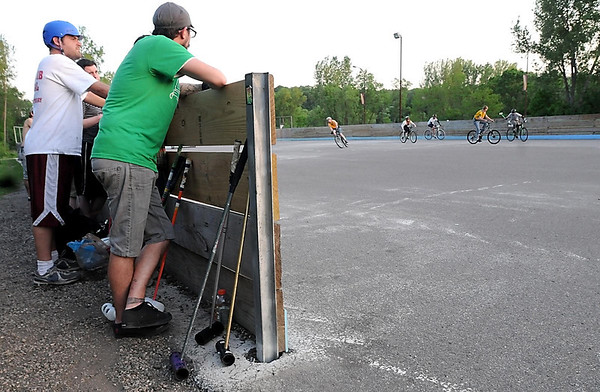 Spectators watch the action during a bike polo match Thursday at the Stoltzman Road rink.