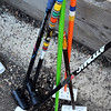Bike polo mallets made from old ski poles, plastic pipe and hockey tape sit in queue waiting for the next match Thursday.