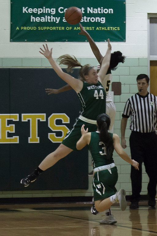 . Westlake\'s Stephanie Randar reaches wide to block Amherst\'s Faith Lewis. Jen Forbus -- The Morning Journal