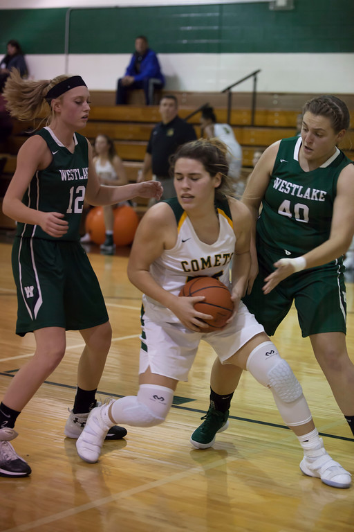 . Amherst\'s Jill Wood protects a rebound as Westlake\'s Angela Campo and Abby Matalavage surround her. Jen Forbus -- The Morning Journal