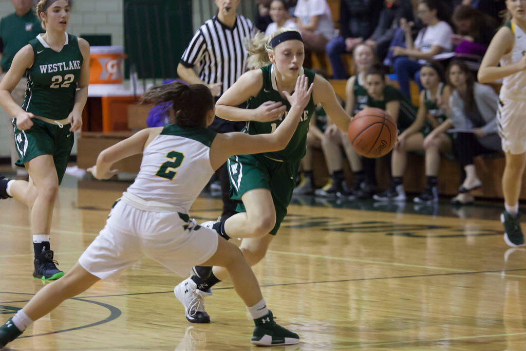 . Westlake\'s Abby Matalavage tries to get by Amherst\'s Audrey McConihe. Jen Forbus -- The Morning Journal