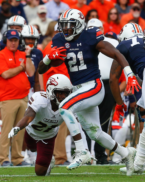 . Auburn running back Kerryon Johnson (21) carries the ball for a first down as Louisiana Monroe cornerback Corey Straughter (21) tries to tackle him during the first half of an NCAA college football game, Saturday, Nov. 18, 2017, in Auburn, Ala. (AP Photo/Butch Dill)