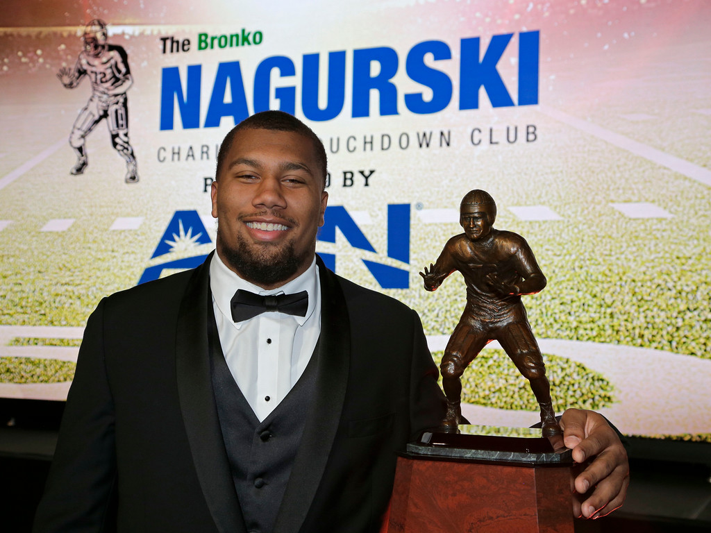. North Carolina State\'s Bradley Chubb poses with the Bronko Nagusrki trophy for the top defensive player in NCAA college football during a photo opportunity in Charlotte, N.C., Monday, Dec. 4, 2017. (AP Photo/Chuck Burton)