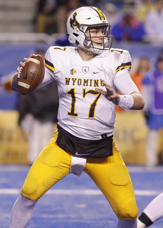 . Wyoming quarterback Josh Allen (17) looks for a receiver during the second half of an NCAA college football game against Boise State in Boise, Idaho, Saturday, Oct. 21, 2017. Boise State won 24-14. (AP Photo/Otto Kitsinger)