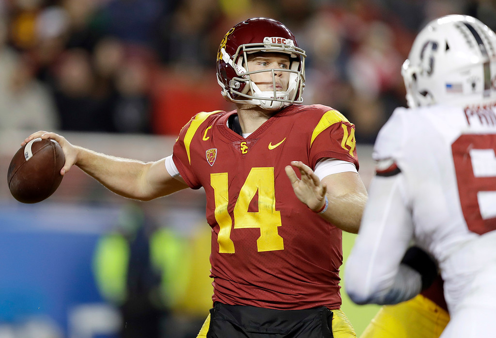 . Southern California quarterback Sam Darnold (14) prepares to throw a pass against Stanford during the second half of the Pac-12 Conference championship NCAA college football game in Santa Clara, Calif., Friday, Dec. 1, 2017. (AP Photo/Marcio Jose Sanchez)