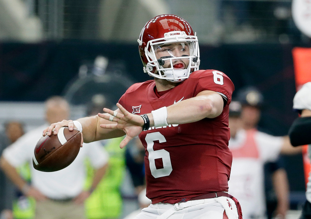 . FILE - In this Dec. 2, 2017, file photo, Oklahoma quarterback Baker Mayfield (6) throws a pass in the first half of the Big 12 Conference championship NCAA college football game against TCU  in Arlington, Texas. Mayfield, reigning Heisman winner Lamar Jackson of Louisville and Stanford running back Bryce Love were chosen as finalists for the Heisman Trophy on Monday, Dec. 4, 2017. (AP Photo/Tony Gutierrez, File)