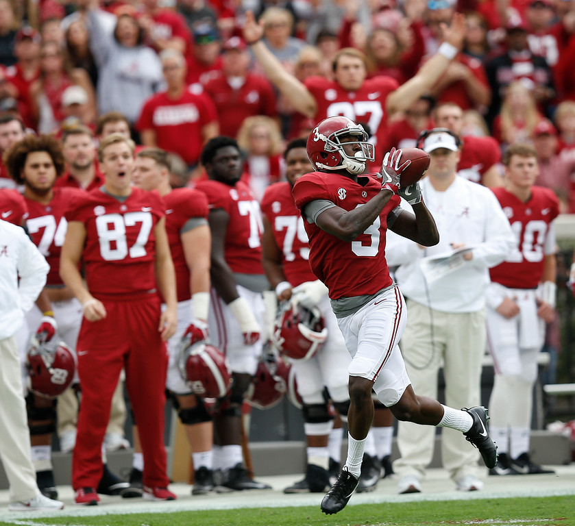 . Alabama wide receiver Calvin Ridley catches the pass and runs in to score a touchdown against Mercer during the first half of an NCAA college football game, Saturday, Nov. 18, 2017, in Tuscaloosa, Ala. (AP Photo/Brynn Anderson)