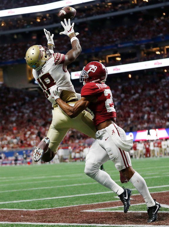 . Florida State wide receiver Auden Tate (18) makes a touchdown catch against Alabama defensive back Minkah Fitzpatrick (29) during the first half of an NCAA football game, Saturday, Sept. 2, 2017, in Atlanta. (AP Photo/John Bazemore)