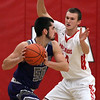 Keystone's Jeremy Gerhardinger looks to pass and is guarded by Colin Myers of Firelands during the first quarter. Turner Campbell of Keystone passes inside and over Colin Myers of Firelands during the second quarter