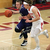 Keystone guard Kevin Mealwitz brings the ball up court against the pressure applied by Patrick Brightbill of Firelands. Randy Meyers -- The Morning Journal