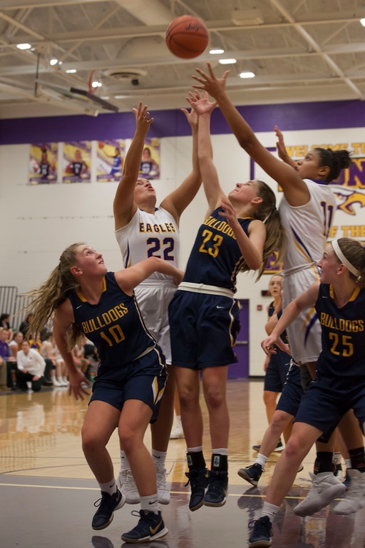 . All arms reach for the ball as a free throw bounces off the rim. Jen Forbus -- The Morning Journal