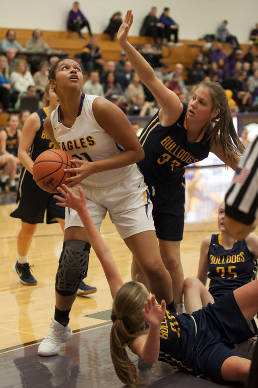 . Avon post Amari Davidson positions herself to take a shot from under the basket and surrounded by Bulldogs. Jen Forbus -- The Morning Journal
