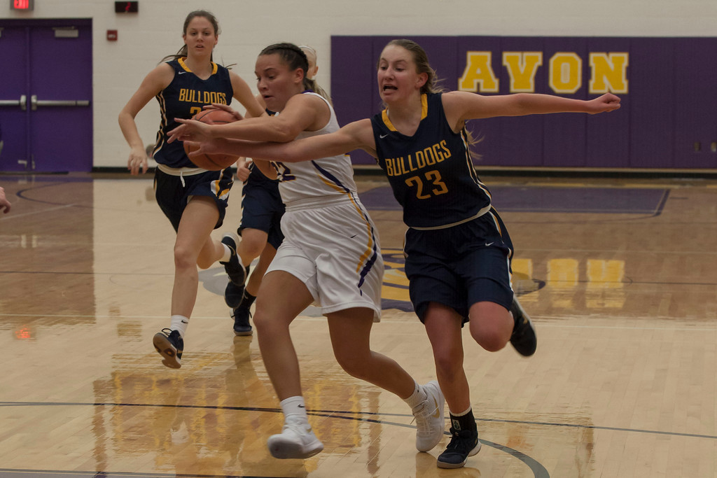 . Olmsted Falls\' Lauren Galaska tries to reach for the basketball as Avon\'s Juliann Walker dribbles toward her basket. Jen Forbus -- The Morning Journal
