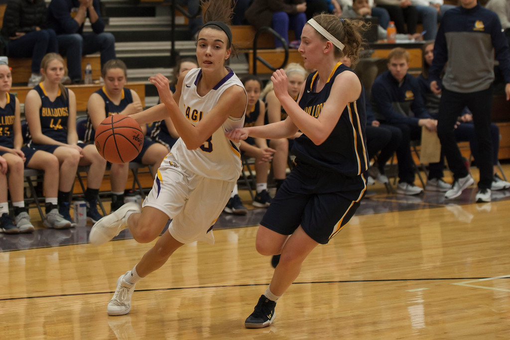 . Olmsted Falls\' Sara Balfour stays right with Eagles guard Elizabeth Flynn as she drives for the basket. Jen Forbus -- The Morning Journal