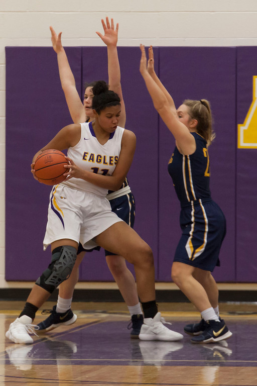 . Avon\'s Amari Davidson puts her hip into a pivot that moves her inside the key and in prime position for a shot. Jen Forbus -- The Morning Journal