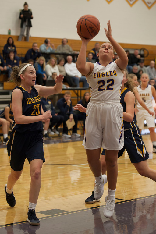 . Avon guard Juliann Walker lays up a shot as Olmsted Falls\' Sara Balfour tries to position herself to block it. Jen Forbus -- The Morning Journal