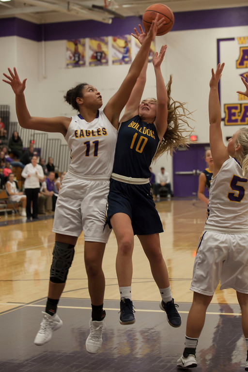 . Avon\'s Amari Davidson gets between Olmsted Falls\' Danielle Stevens and the basket, tipping her shot away. Jen Forbus -- The Morning Journal