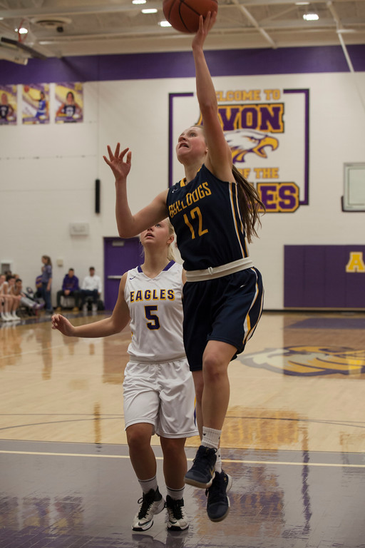 . Olmsted Falls\' Allison Milligan lays up a shot as Avon\'s Karlee Clements looks on. Jen Forbus -- The Morning Journal