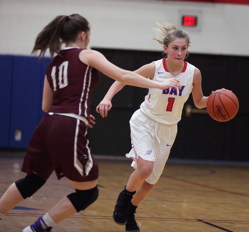. Bay\'s Kayla Koz brings the ball up court against the defensive pressure applied by Nani Meese of Rocky River. Randy Meyers -- The Morning Journal