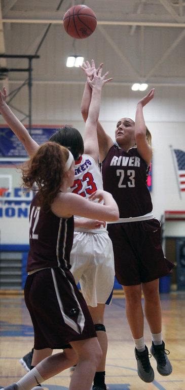 . Hanna Chapman of Rocky River shoots and scores over Jessica Rychel of Bay during the first quarter. Randy Meyers -- The Morning Journal