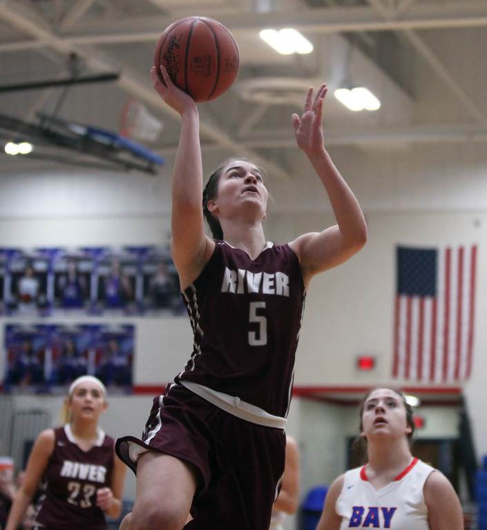 . Anne Beirne of Rocky River scores on a drive in the lane during the first quarter against Bay. Randy Meyers -- The Morning Journal