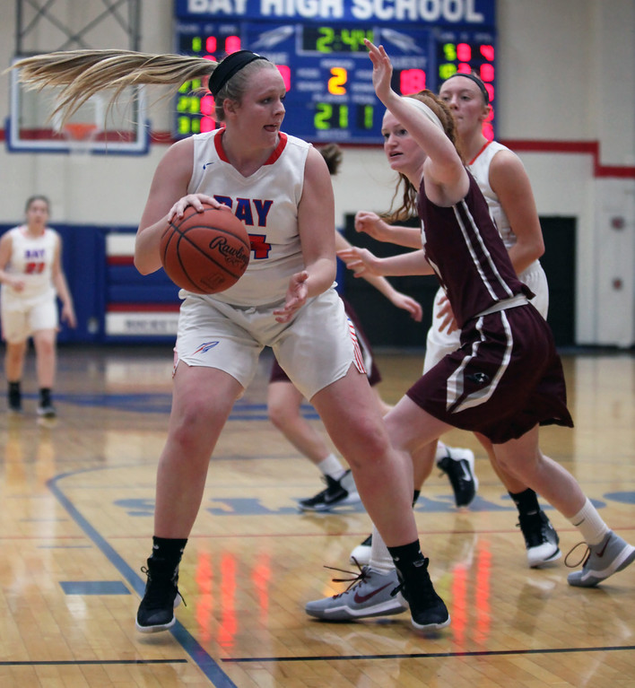 . Bay\'s Halle Orr catches the ball in the low post as Rachel Moeller of Rocky River defends during the second quarter. Randy Meyers -- The Morning Journal
