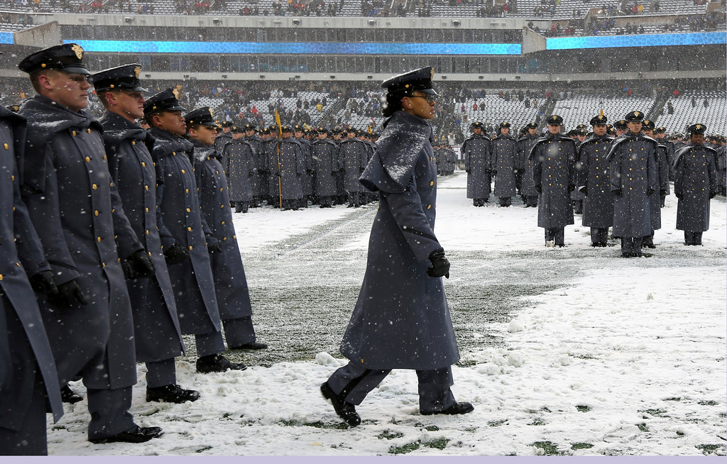 ". First Captain Simone Askew, the first African-American woman to lead the Corps of Cadets at West Point, leads the ""march on\"" of Army Cadets before the 118th meeting of the annual Army Navy football game Saturday Dec. 9, 2017 in Philadelphia. (AP Photo/Jacqueline Larma)"