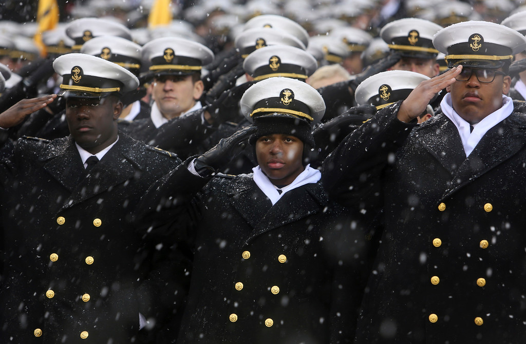 . Navy Midshipmen salute during the national anthem just before the 118th meeting of the annual Army Navy football game, Saturday Dec. 9, 2017 in Philadelphia. (AP Photo/Jacqueline Larma)