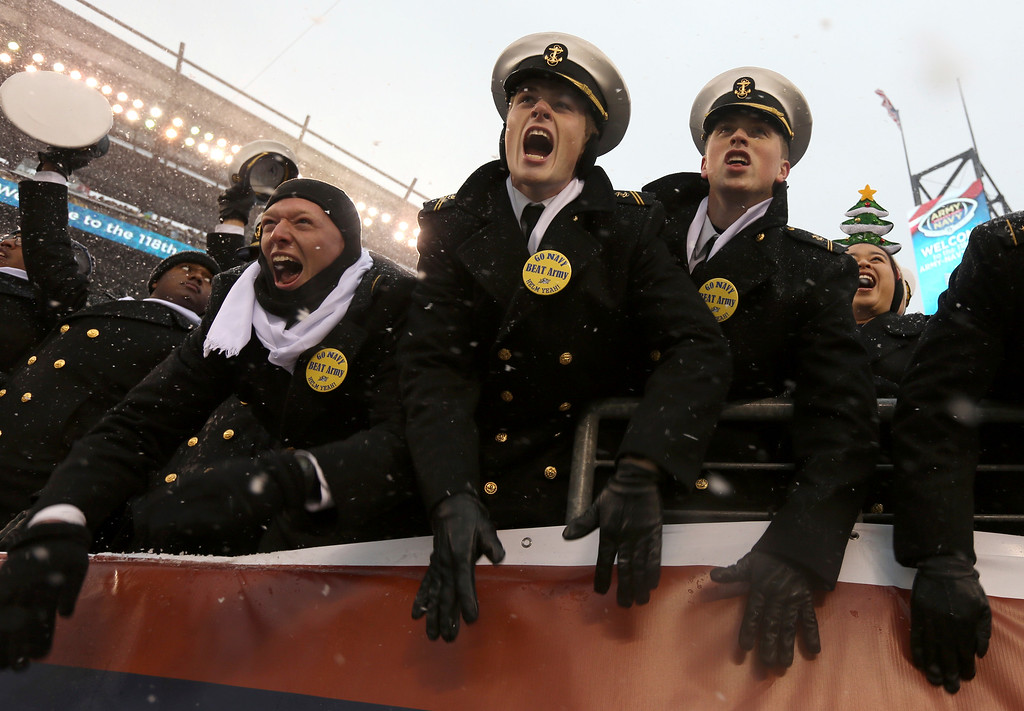 . Navy Midshipmen cheer as the 118th meeting of the annual Army Navy football game gets underway, Saturday Dec. 9, 2017 in Philadelphia. (AP Photo/Jacqueline Larma)