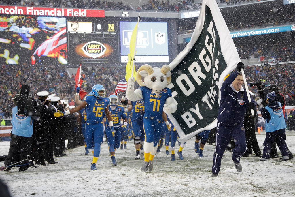 . Navy takes the field ahead of an NCAA college football game against the Army and the Navy, Saturday, Dec. 9, 2017, in Philadelphia. (AP Photo/Matt Rourke)