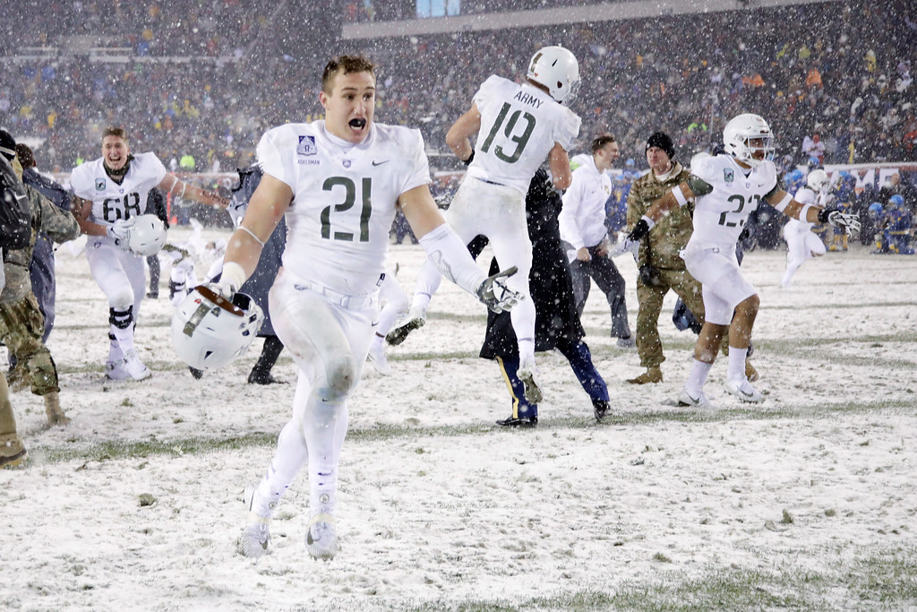 . Army\'s Alex Aukerman (21) celebrates with his teammates after defeating Navy in an NCAA college football game, Saturday, Dec. 9, 2017, in Philadelphia. Army won 14-13. (AP Photo/Matt Rourke)