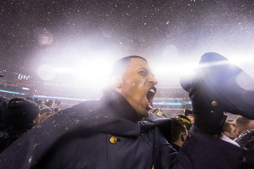 . An Army Cadet celebrates on the field after Army defeated Navy in an NCAA college football game, Saturday, Dec. 9, 2017, in Philadelphia. Army won 14-13. (AP Photo/Matt Rourke)