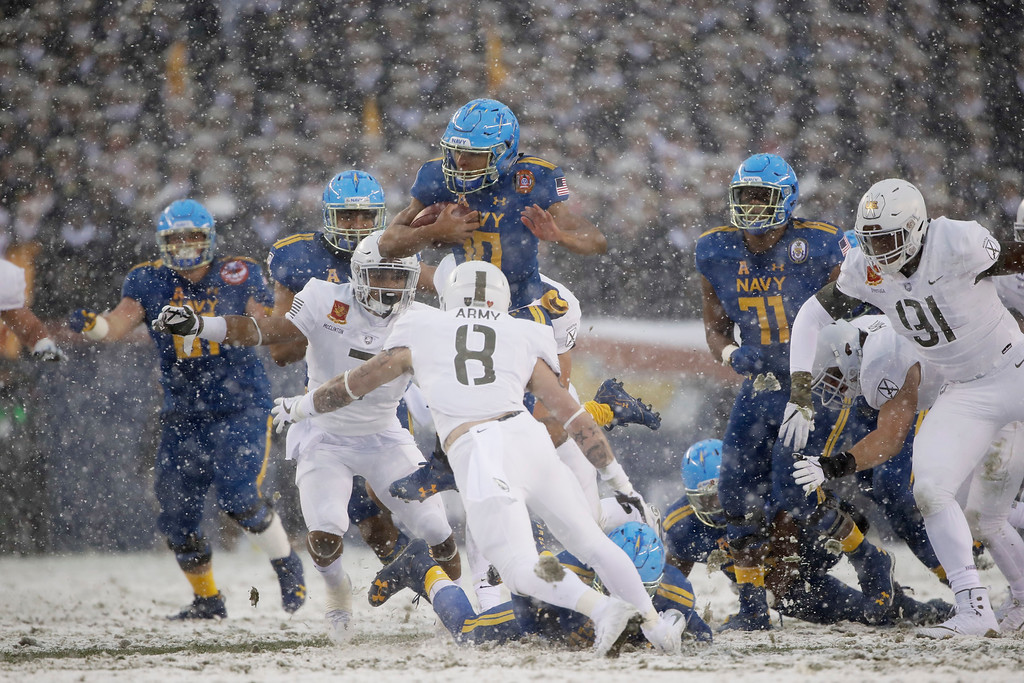 . CORRECTS THE TEAMS-Navy\'s Malcolm Perry (10) runs the ball against Army during the first half of an NCAA college football game, Saturday, Dec. 9, 2017, in Philadelphia. (AP Photo/Matt Rourke)