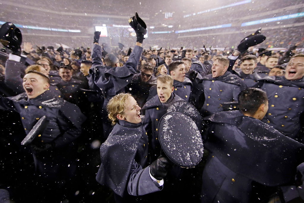 . Army Cadets celebrate on the field after Army defeated Navy in an NCAA college football game, Saturday, Dec. 9, 2017, in Philadelphia. Army won 14-13. (AP Photo/Matt Rourke)