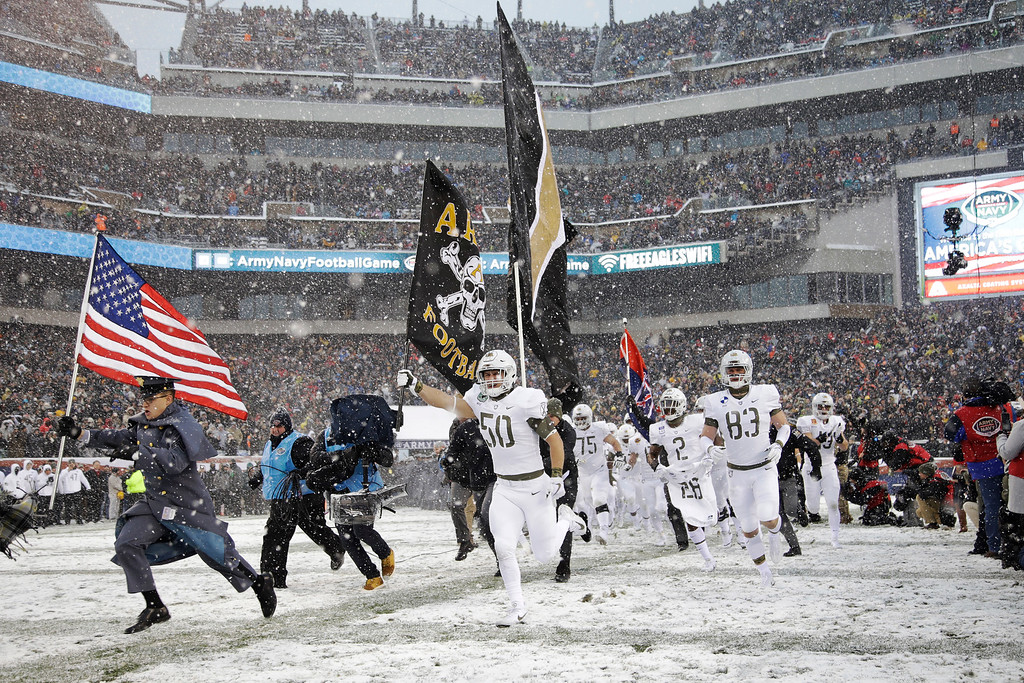 . Army takes the field before the first half of an NCAA college football game against the Navy, Saturday, Dec. 9, 2017, in Philadelphia. (AP Photo/Matt Rourke)
