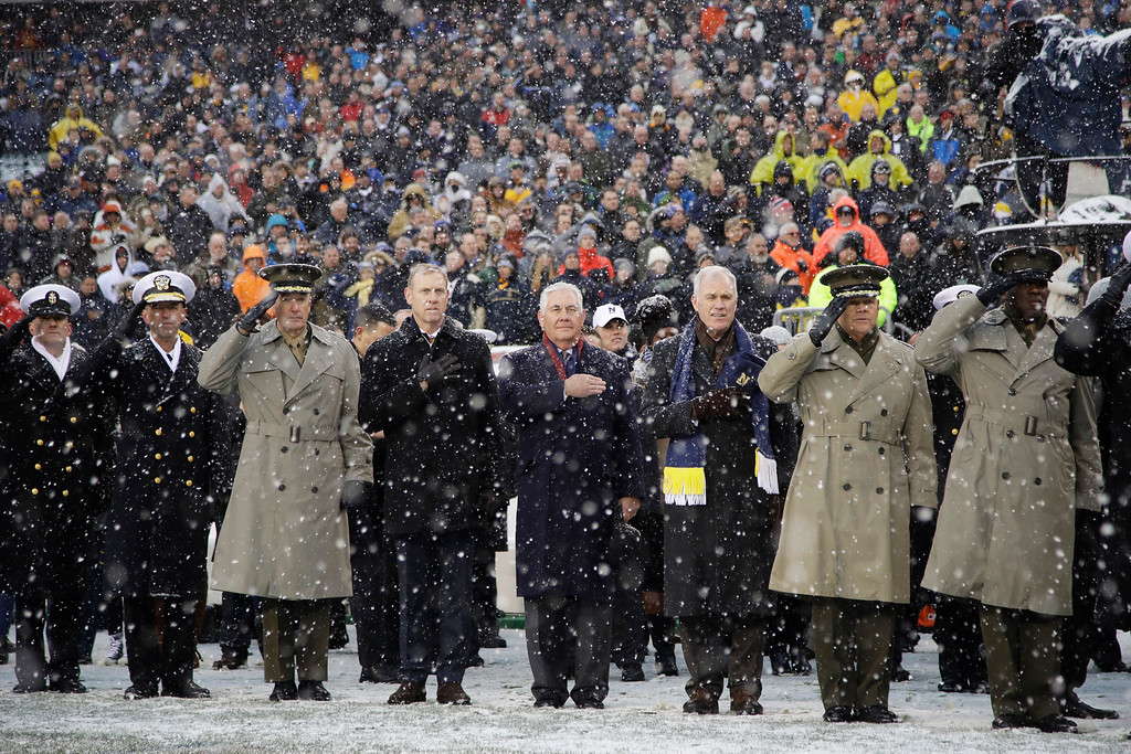 . U.S. Secretary of State Rex Tillerson, center, stands for the National Anthem ahead of an NCAA college football game between the Army and the Navy, Saturday, Dec. 9, 2017, in Philadelphia. (AP Photo/Matt Rourke)