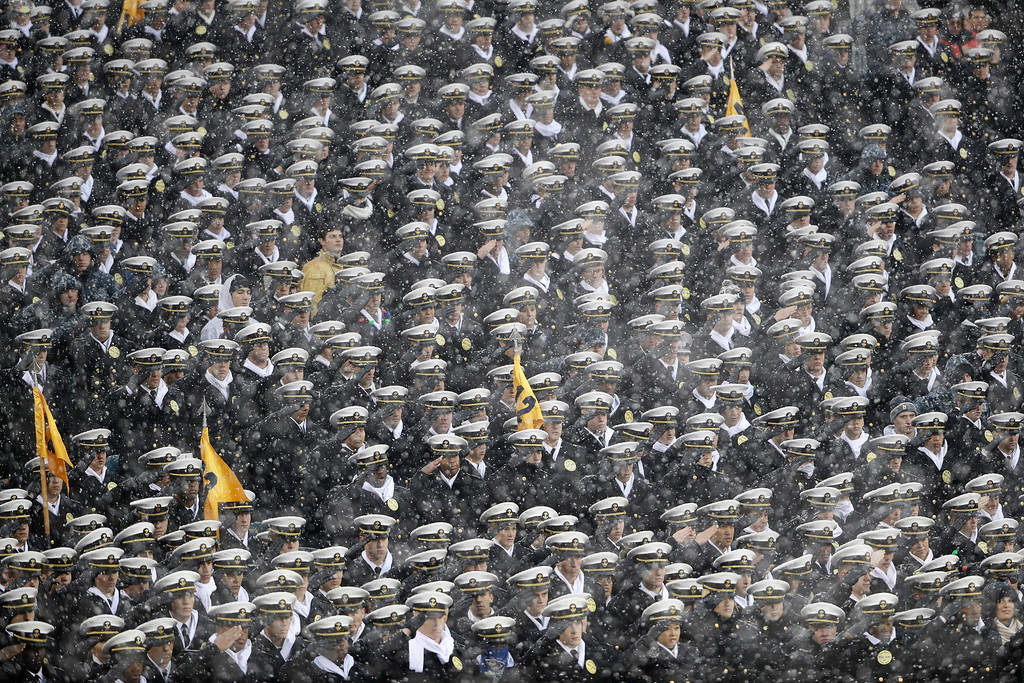 . Navy Midshipmen salute during the National Anthem ahead an NCAA college football game between the Army and the Navy, Saturday, Dec. 9, 2017, in Philadelphia. (AP Photo/Matt Rourke)