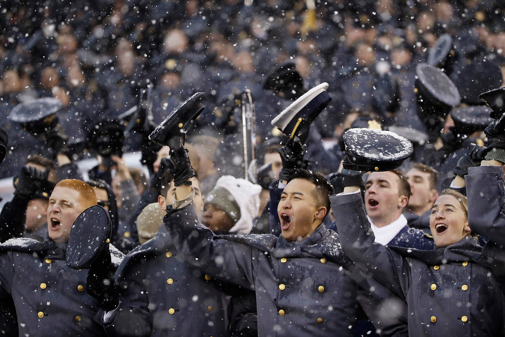 . Army Cadets cheer during the first half of an NCAA college football game against Navy, Saturday, Dec. 9, 2017, in Philadelphia. (AP Photo/Matt Rourke)